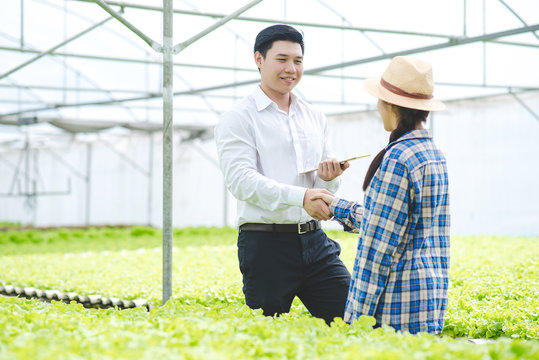 Asian business man hand shake with asian woman farmer after successful agreement.