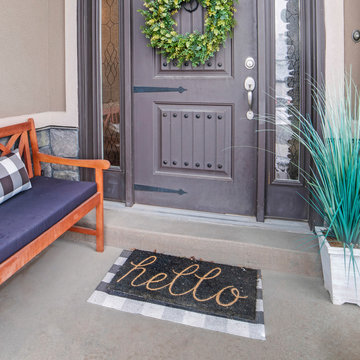 Square frame Beautiful home entrance with gray door sidelights and huge transom window