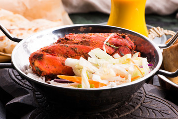 Close-up of a plate of chopped tandoori chicken