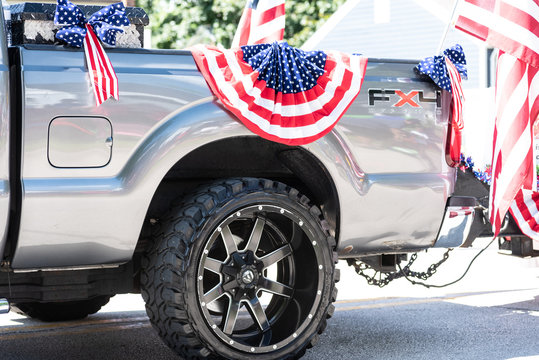 Barrington, Illinois/USA – July, 4 2019: Silver Ford F-150 FX4 pickup track decorated with stars and stipes for the hometown Fourth of July Parade