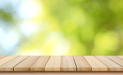 blurred background of green park in summer, Wood table top on shiny bokeh green background. For product display Fotomurales