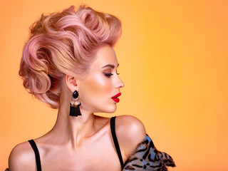 Fotorolgordijn Kapsalon Beautiful woman with creative hairstyle, vivid makeup. Fashionable girl. Beautiful face of young woman with red lips. Stunning blonde girl. Bright eye makeup. Attractive caucasian model with earrings