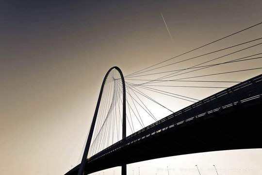 Low Angle View Of Silhouette Margaret Hunt Hill Bridge Against Clear Sky During Sunset