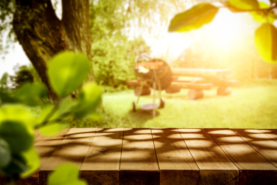 Spring sunny day and desk of free space cover of shadows.Copy space for your product and spring sun light.