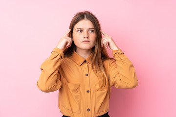 Ukrainian teenager girl over isolated pink background having doubts and thinking