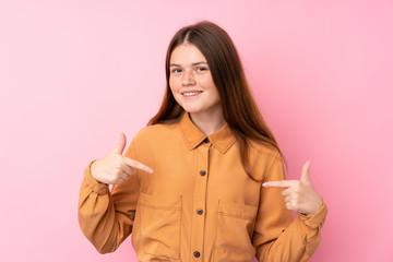 Ukrainian teenager girl over isolated pink background proud and self-satisfied