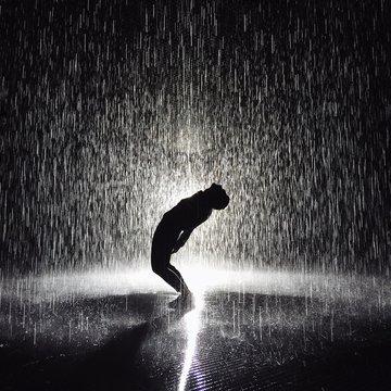 Full Length Of Man Bending Over Backwards While Standing On Street During Rainy Season