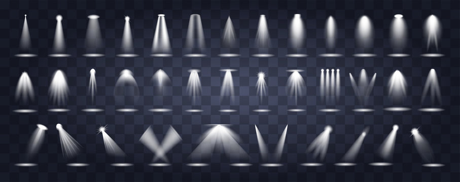 Large set of stage lighting Vector icons showing spotlights shining down through the darkness with various orientations, narrow or broad beams, and single through to four beams together