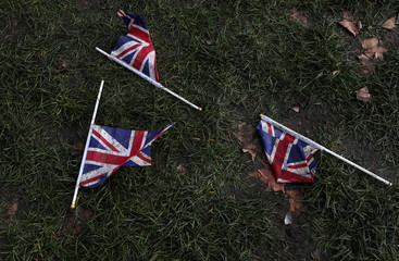 Union Jack flags lay on the ground at Parliament Square in London