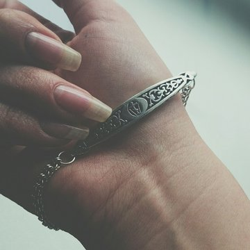 Cropped Hands Of Woman Wearing Bracelet