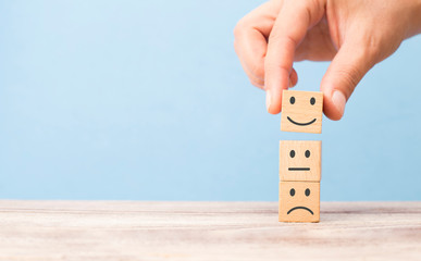 customer satisfaction concept. smiling face on sad face Wall mural