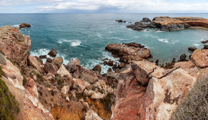 Picturesque view of red rocks and Mediterranean sea from the cape Cabo de Palos, Murcia, Spain