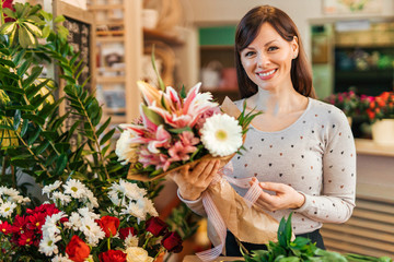 Portrait of a charming florist at work.