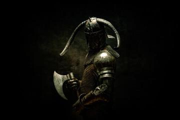 Portrait of a Viking Berserker warrior, holding an ax in his hands Fototapete