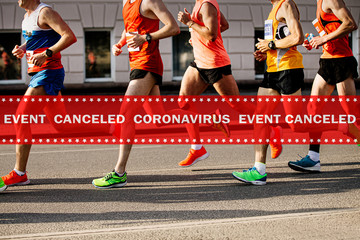 Fototapete - warning tape event canceled coronavirus in background men running marathon