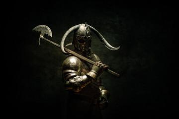 Portrait of a Viking Berserker warrior, holding a halberd on his shoulder