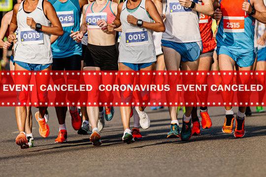 warning tape event canceled coronavirus in background group of runners running marathon