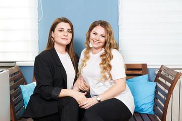 Two Young Women Models Plus Size. Close-up Portrait. Friendship