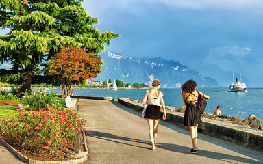Young girls at the embankment at Geneva Lake in Vevey, Vaud canton, Switzerland