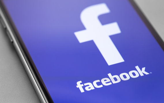 Facebook symbol on the screen smartphone closeup. Facebook is largest and most popular social networking site in the world. Moscow, Russia - September 23, 2019