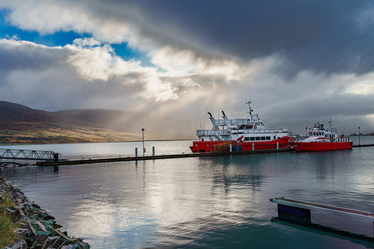 Ship docking beside the harbor as the sunlight broke through the heavy cloud -- Akureyri, Iceland