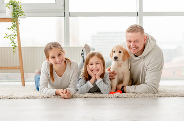 Father with daughters and puppy