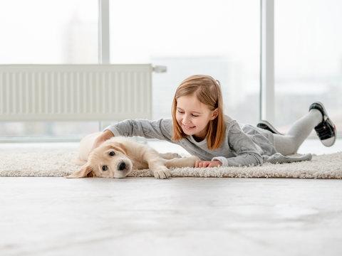 Cute little girl near puppy