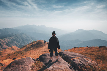 A woman standing on the slopes Beautiful mountain views Wall mural