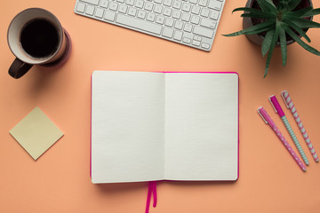 Stock photo of an open notebook page in an office desk table