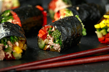 Vegetarian paleo diet nori wraps with tuna, cucumber, sweet pepper and microgreen radish sprouts