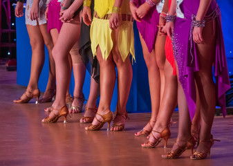 Girls in ball gowns at dance competition