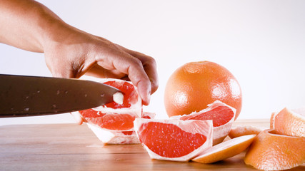 grapefruits being seeded on wooden table