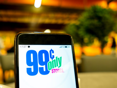 In this photo illustration the 99 cents store logo is seen displayed on a smartphone