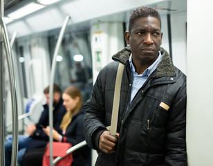 African man in metro train