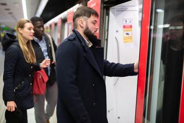 Guy getting on subway train