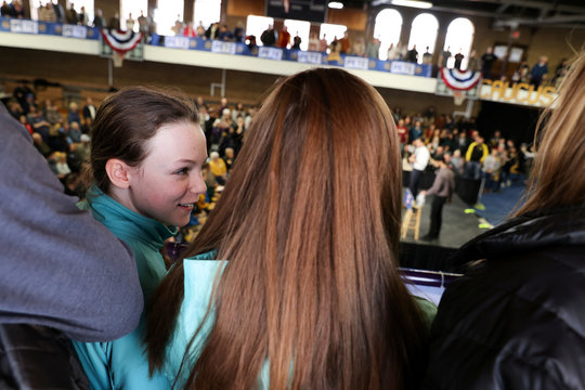 Lockett smiles with her family after Democratic presidential candidate Buttigieg answered her question during a campaign event in Dubuque, Iowa