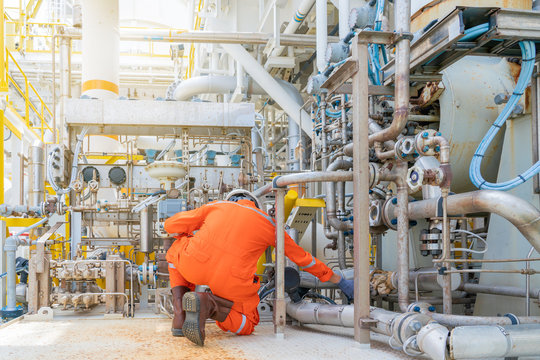 Mechanical engineer inspector check control valve of seal gas and lube oil system of centrifugal type sales compressor and turbine engine at offshore oil and gas processing platform.