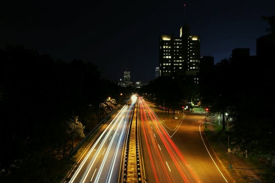HIGH ANGLE VIEW OF LIGHT TRAILS ON CITY ROAD AT NIGHT