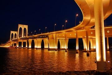 Foto op Aluminium Gondolas Illuminated Bridge Over River Against Sky At Night