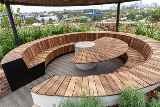 outside wooden tables and benches on a rooftop