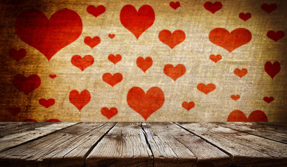 Empty old wooden table background with valentines day theme in background