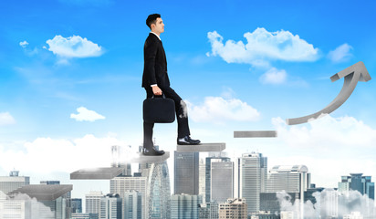 Business man climbing up stair steps to career success with business district and horizon skyline...