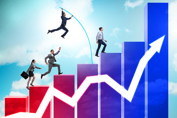 Business people vault jumping over bar charts