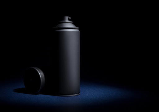 Spray can with spray paint on a black background