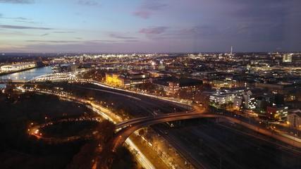 Fototapeta HIGH ANGLE VIEW OF ILLUMINATED CITY AT NIGHT