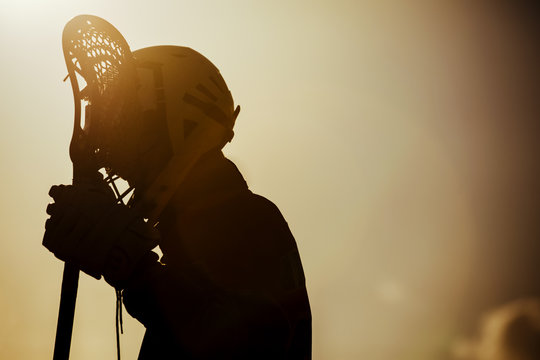 Lacrosse Player Against Sky During Sunset