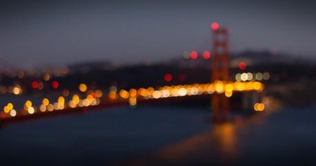 Defocused Image Of Illuminated City Against Sky At Night