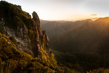 Setting sun lit up the valleys and cliffs of the Pinnacles, Coromandel, New Zealand Wall mural