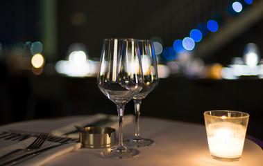 Papiers peints Vin Close-Up Of Wine Glasses On Illuminated Table