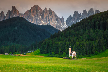 Wall Mural - Beautiful St Johann church in Santa Maddalena mountain village, Italy